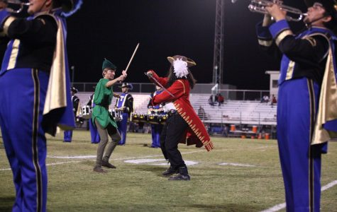 Peter Pan (Dawson Lopez) and Captain Hook (Eulysses Urrea) fight with swords during the halftime show.