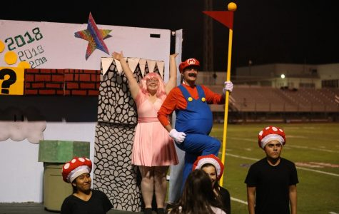 Abel Lopez rescued Princess Peach, Jenna Yarbrough, from a baby Thunderbird on the Senior class float.