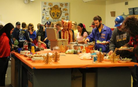 Teacher and students gather for a Halloween lunch as