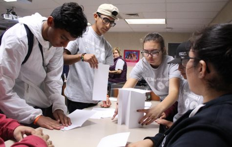 Rodolfo Magana, Marvin Gama, Kaylene Teter, and friends trying to build a stable tower out of construction paper.