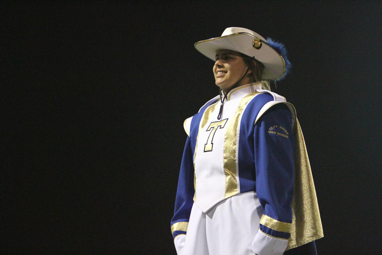 Drum Major Angie Self conducts the show and leads the band.