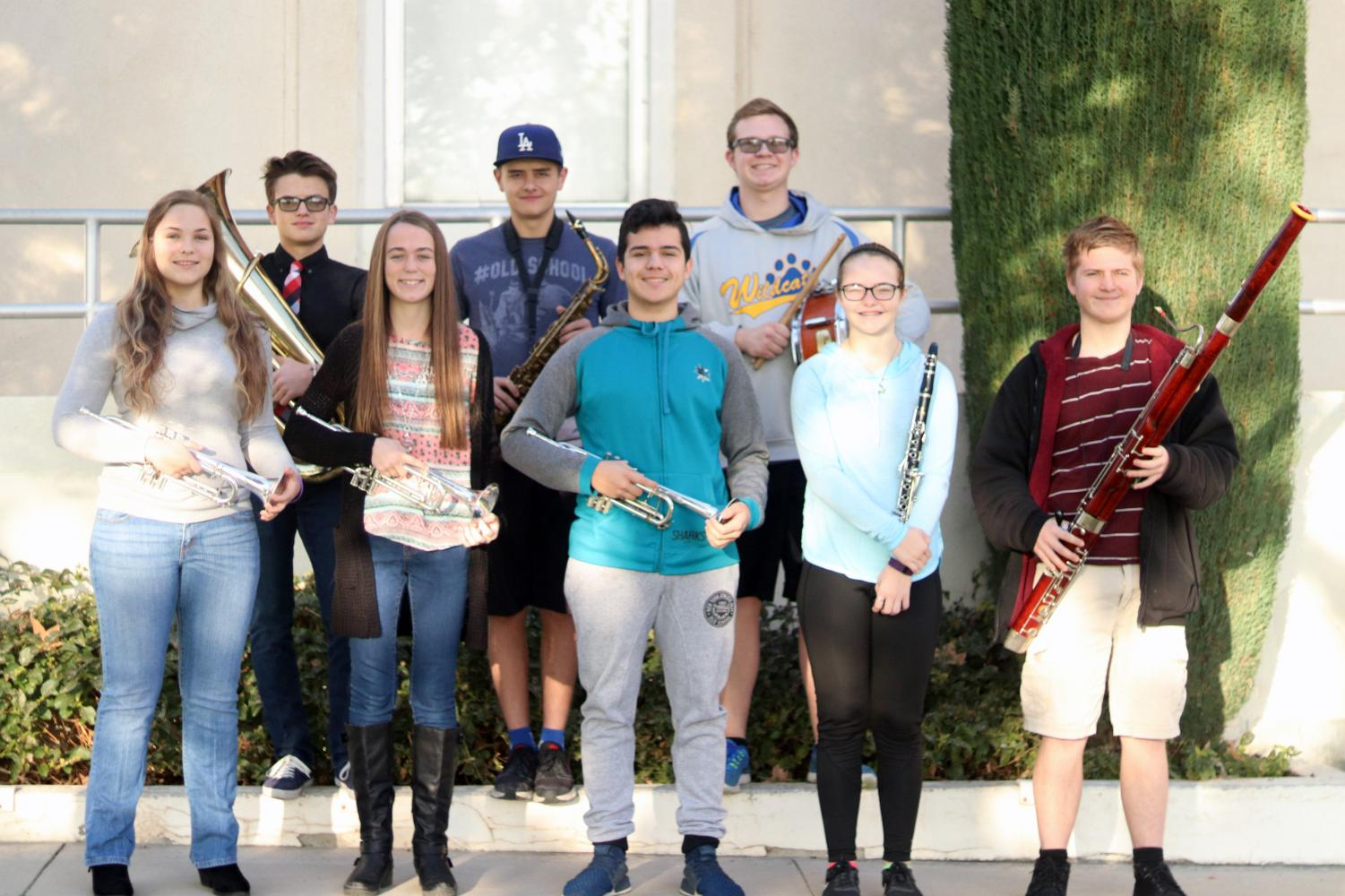 Honor Band and Orchestra participants Ricky Posey, Dennis Posey, Tanner Ashmore, Taylor Reed, Kylie Campbell, Luis Moncada, Raygan Wescott, and Nathaniel Morris