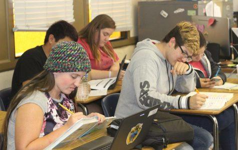 Senior students Mathew Loucks and Harmony Hartzel study for finals in Mr. Morris classroom
