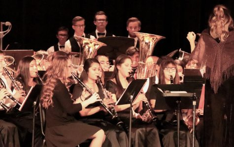 The concert band conducted by Amanda Posey