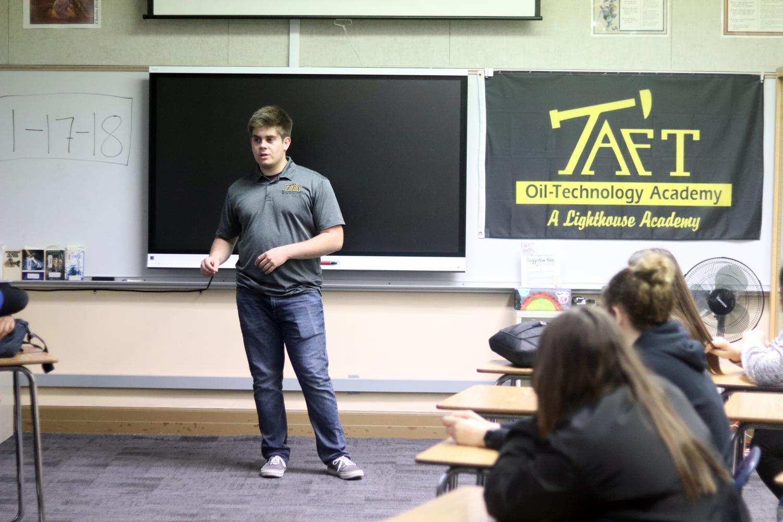 Clayton Hamblin discussing the Oil Tech program with the freshmen of TUHS