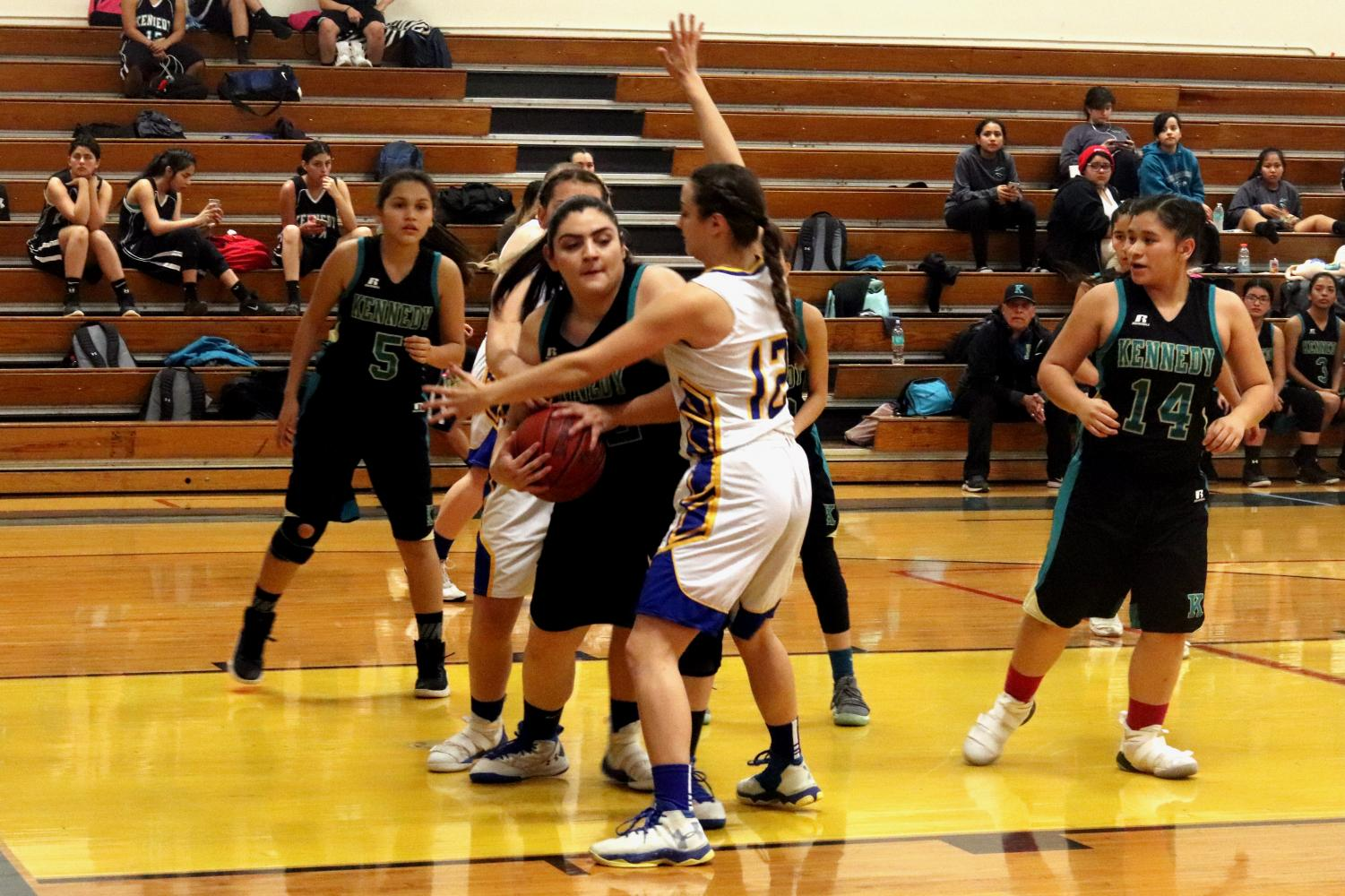 Morgan Pulido blocking a Kennedy player from passing the ball.