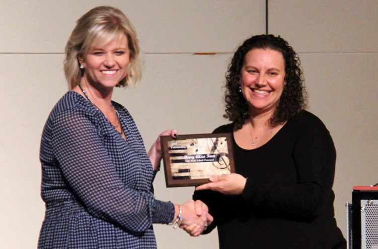 Mary Alice Finn is given her award by Amanda Issac, KCMEA president for Outstanding Administrator.