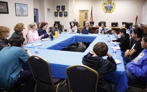 Students discuss concerns and ideas at Pizza with Principal Mary Alice Finn.
