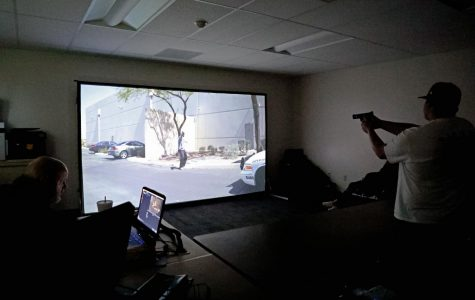 Tom White uses the simulator to teach Christian Burleson to control the situation.