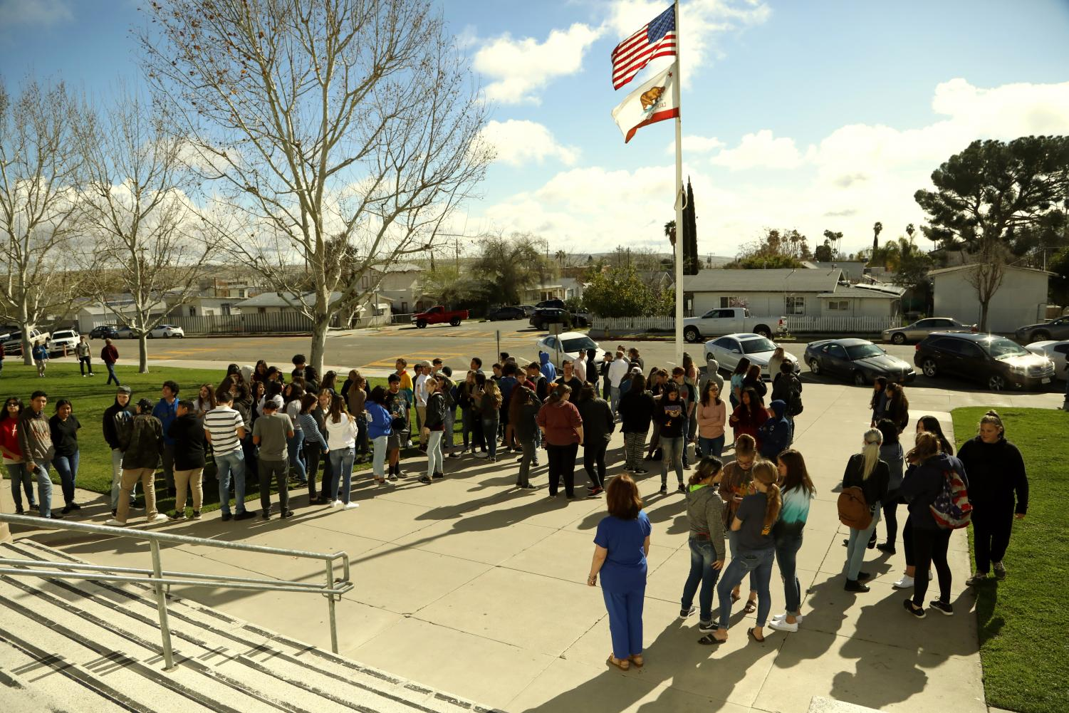 Students gathered outside the school on Wednesday to pray for peace.