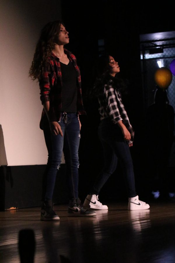 Xitlaly Gonzales and Karrigan Yancey dancing together.