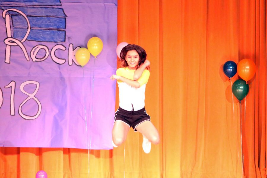 Dariana Calderon jumping high in her dance along with friends Saskia Haag and Millie Reynoso (not pictured).
