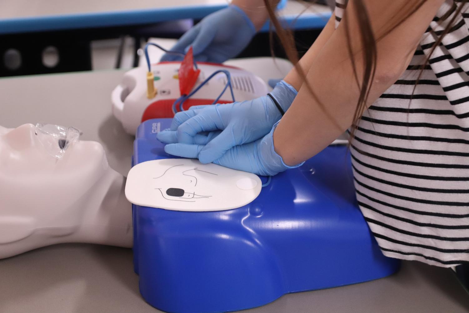 Kayla Hoffman performing CPR on a simulator.
