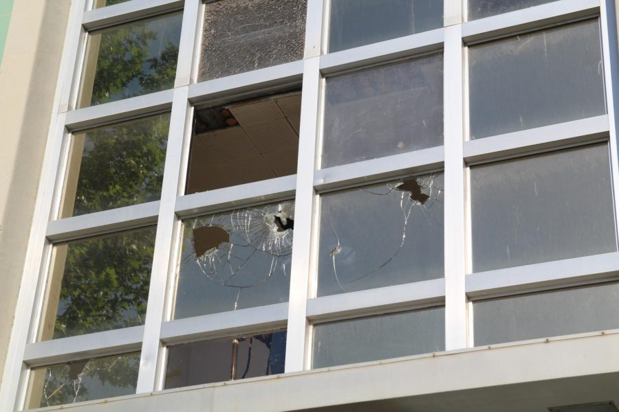 Vandalized+windows+in+front+of+the+science+building+on+Wildcat+Way.