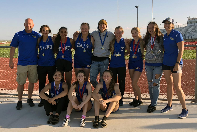 Varsity girls' track team win SSL Championship.