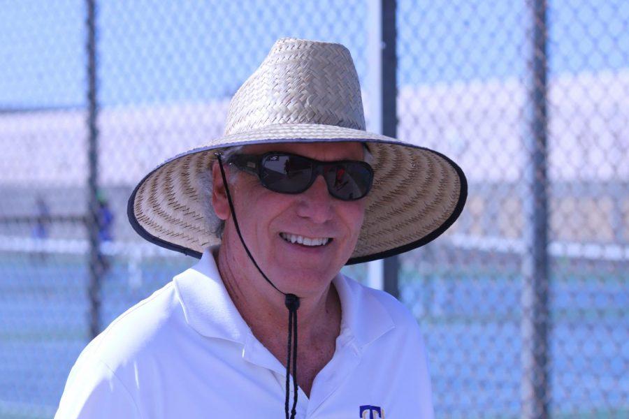 Mr. Carnal coaching tennis