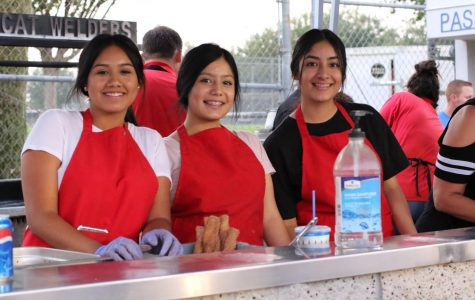 FCCLA members Litzy Lopez, Vanessa Carreno, and Erica Carrillo working the fundraiser during the football game Friday, August 24. FCCLA is run by the students, with Carlos Chavira as the Club Adviser. When asked about the fundraiser Chavira said,