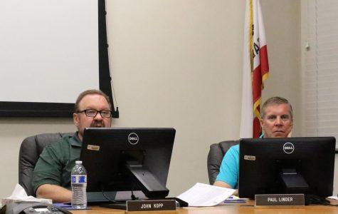 John Kopp and Paul Linder attending the Sept. 10 board meeting. Kopp speaking to the those in the board room.