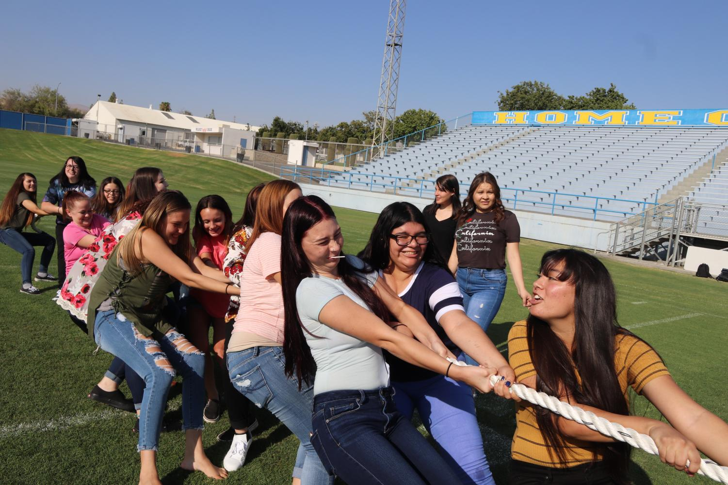 Taft High seniors participate in tug-of-war during the Day of Welcome. Cecily Bonton, Jade Gessel, and Graciela Mendoza are pictured in front.