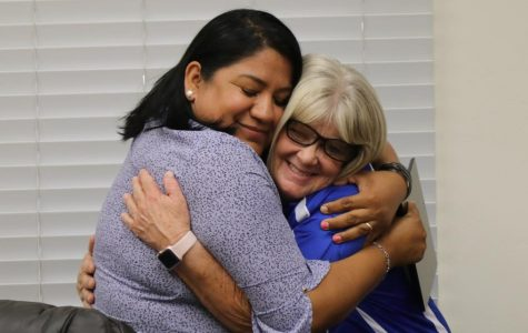 Hugging one last time. Monica Torro awards Mary Miller with a plaque for her many years of service at TUHS. Miller spent 12 years working as campus supervisor. In total she has worked around 33  years doing various jobs. Miller stated,