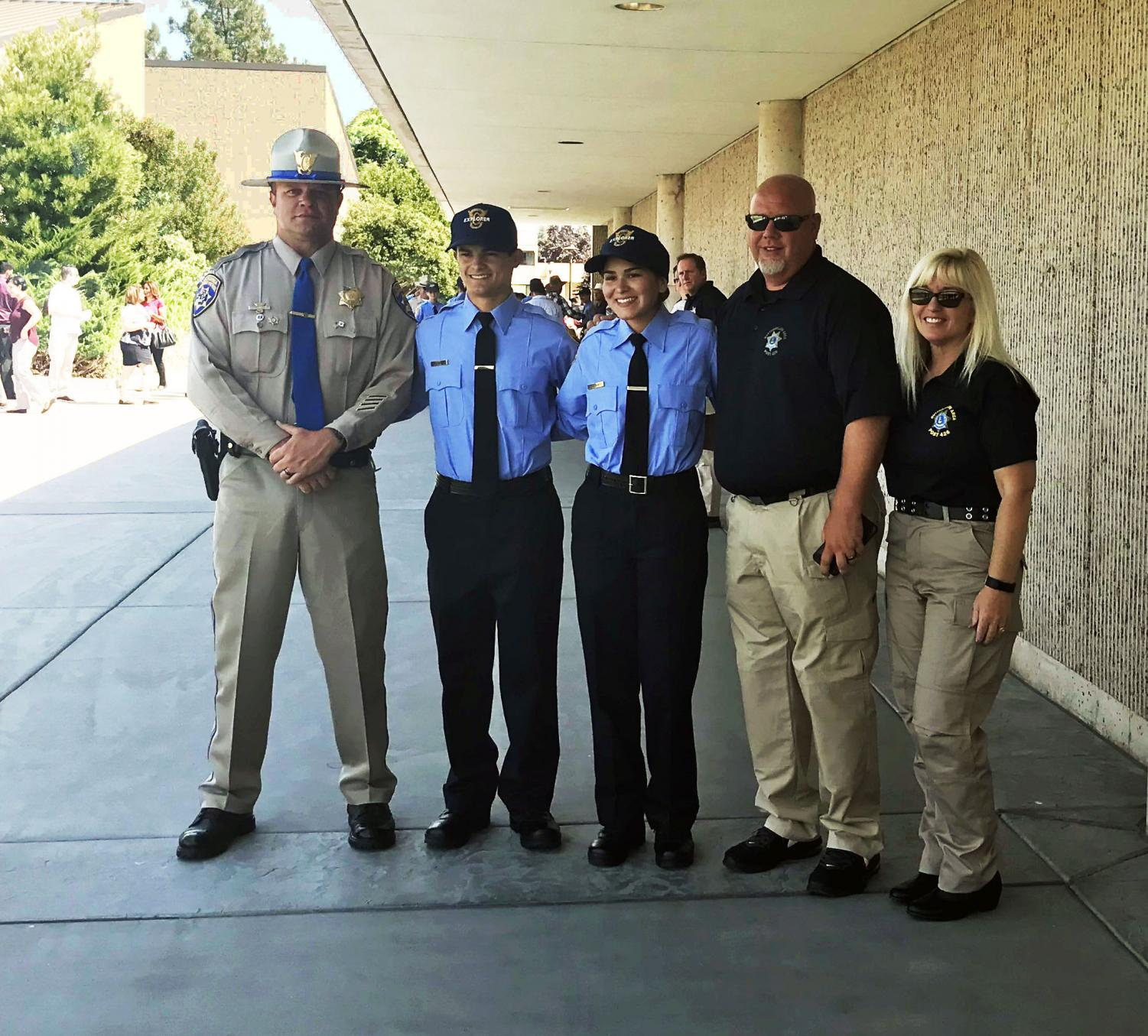 Accomplishing their goals. Lieutenant Michael White and sergeant Reagan Montgomery smiling proudly after the week long academy. Those standing alongside them are Officer Adam Taylor, Tommy White, and Korina Rawls. Tommy White proudly says,