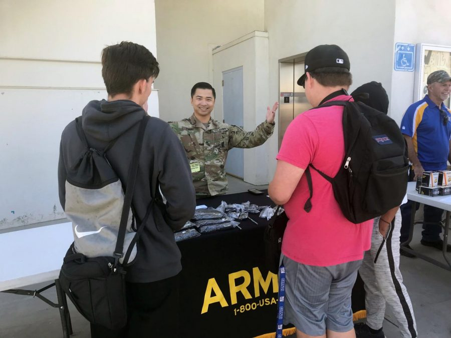 Taft High students checking out the Army booth. This booth was for students who are   curious about the Army. Many students could interact with each other in the variety of clubs Taft High has to offer.