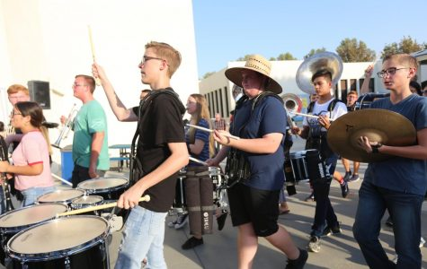 The percusssion portion of the band makes their way to the band room after their performance at back to school night. Some songs they played were Seven Nation Army, Irresistible, Confident, and Happy.