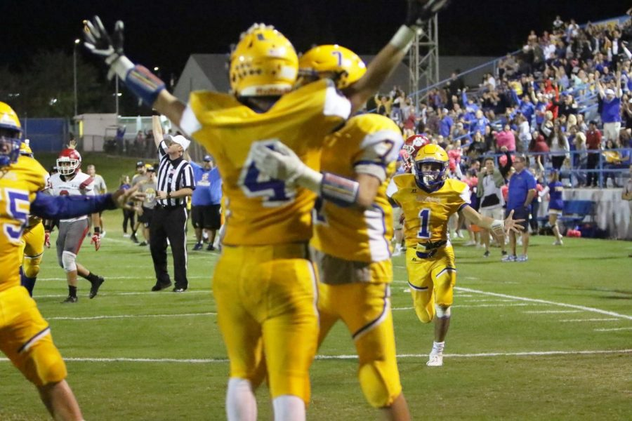 Taft High players rush Brett Walls to celebrate his clutch touchdown catch. This gave the Wildcats the lead late into the game.