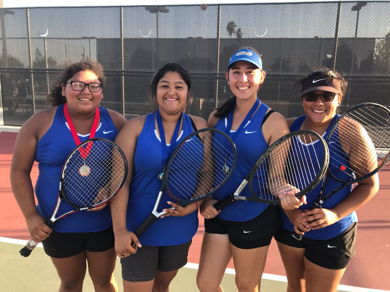 Taft for the win. Valerie Munoz, Cielo Woggn, Diana Huizar, and Jessica DeLaCruz are all excited about their win. This was the second time that the Taft High varsity team won the SSL Championship in the league's 54 history.