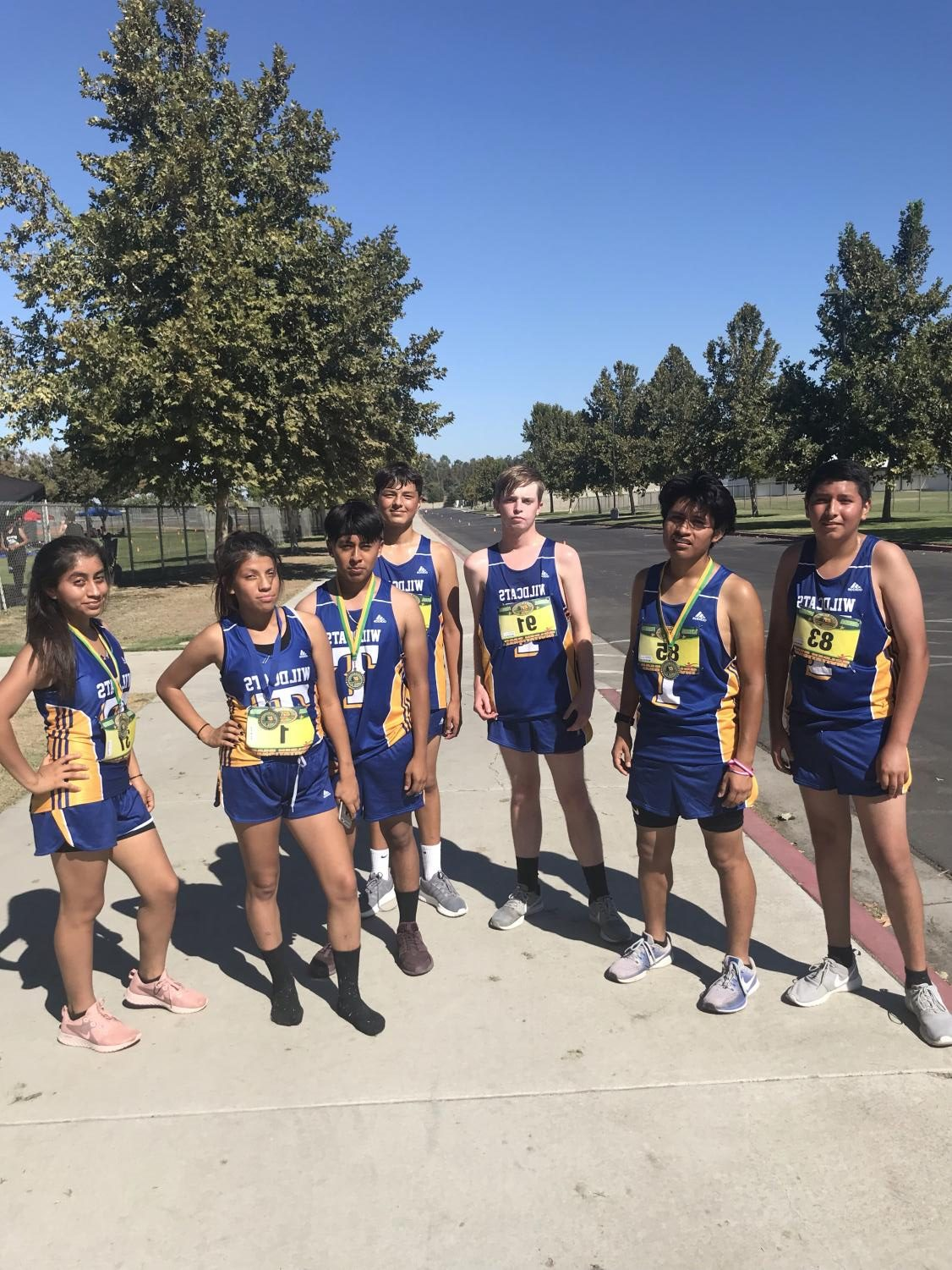 TUHS runners after they ran their race. The runner with the blue medal (Marimar Torres) got first place.