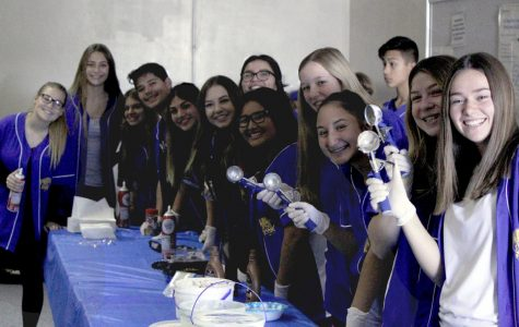 Human Element members pose while giving out ice cream. Photo taken at the 4.0 ice cream social.