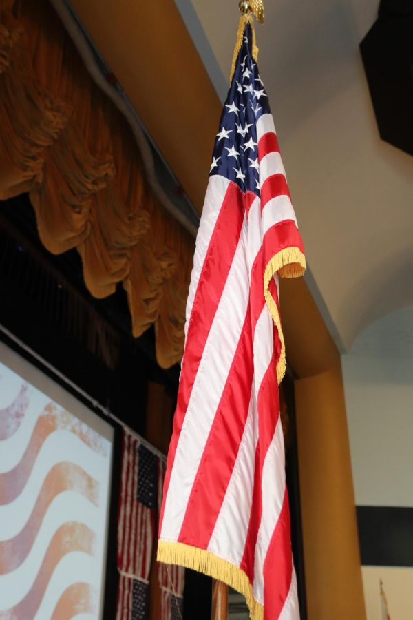 Flag+stands+tall+while+TUHS+students+honor+Veterans.+Human+Element+students+invited+Veterans+to+tell+their+experiences.+Advisor+Emmy+Lou+Heber+said%2C+%22+The+Human+Element+students+and+I+were+very+happy+with+the+opportunity+to+put+on+such+a+well-received+event.+We+were+thrilled+to+be+able+to+honor+Veterans+and+have+their+stories+shared+with+our+student+body.+We+are+looking+forward+to+doing+this+again+in+the+future.%22+