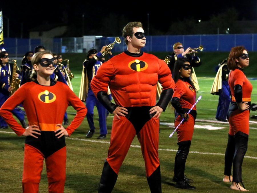 The Incredible family, Tanner Ashmore (Mr. Incredible), Reanna Rowland (Dash), Ashly Ramirez (violet), Diana Huizar (Mrs. Incredible) does their super pose. They're getting ready to take on Syndrome and his omnidroid in a vicious fight. Band director Amanda Posey says