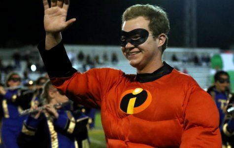 Tanner Ashmore as Mr. Incredible waving at adoring fans. If students or staff would like to see the band's display, some upcoming events are as listed: November 10th Stockdale competition and Christmas parade on December 11th. Onlooker, Thalia Villanueva says,