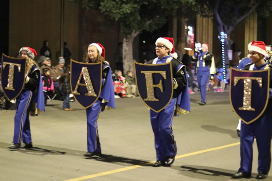 Taft High band marching in the parade lead by Chris Green, Carson Morgan, Taylor Brown, and Reanna Rowland.