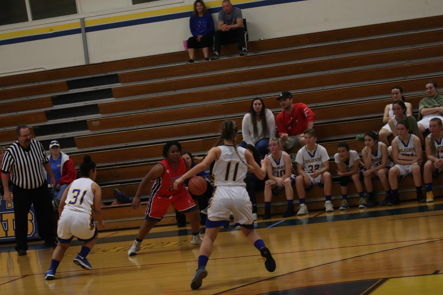 Sierra Kozloski and Alana Iotamo trying to distract the other player so they can get the ball back.