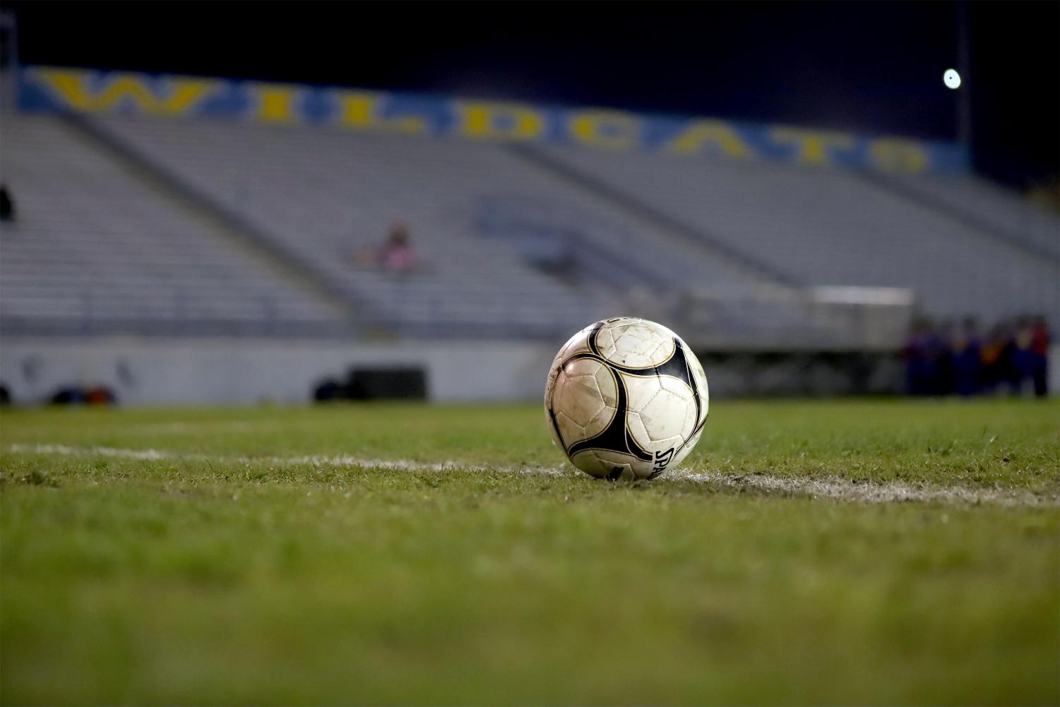 Soccer ball placed in the middle of the Taft High's Martin Memorial Stadium field during halftime for the TUHS Wildcat JV boys' soccer team.