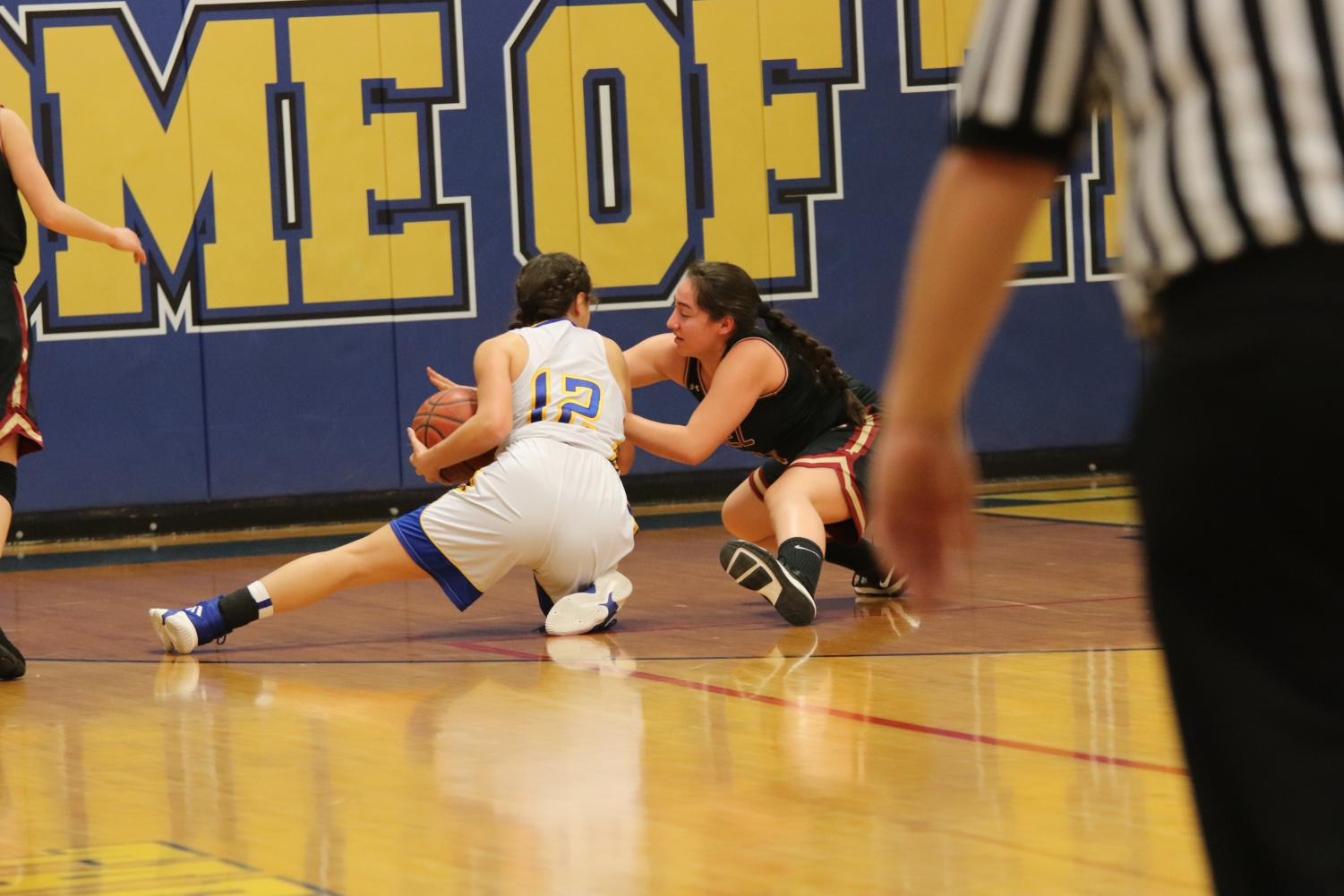 Morgan Pulido protecting the ball from an opponent. She has been playing on the varsity level for the past two years and has continued to work hard everyday.