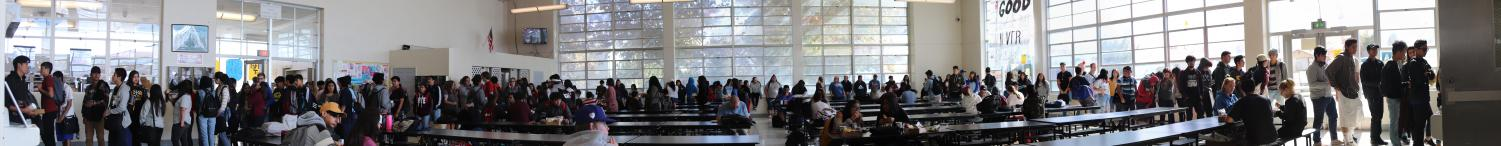 Students crowd the cafeteria in order to get lunch out of the fast food line (left side) and the hot lunch line (right side)