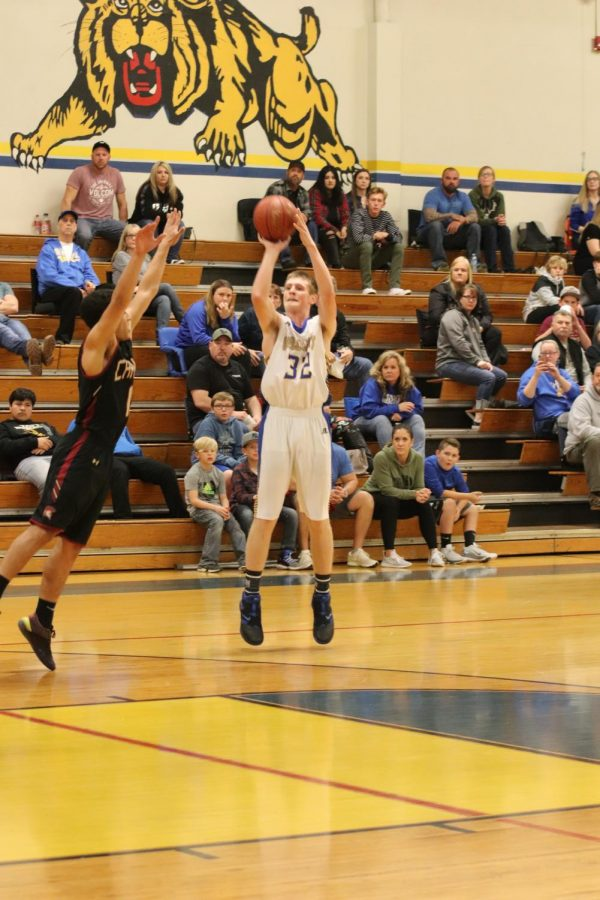 In+an+intense+game+against+the+Titans%2C+Dylan+Self+hits+a+three+pointer+to+help+lead+his+team+to+an+important+win.