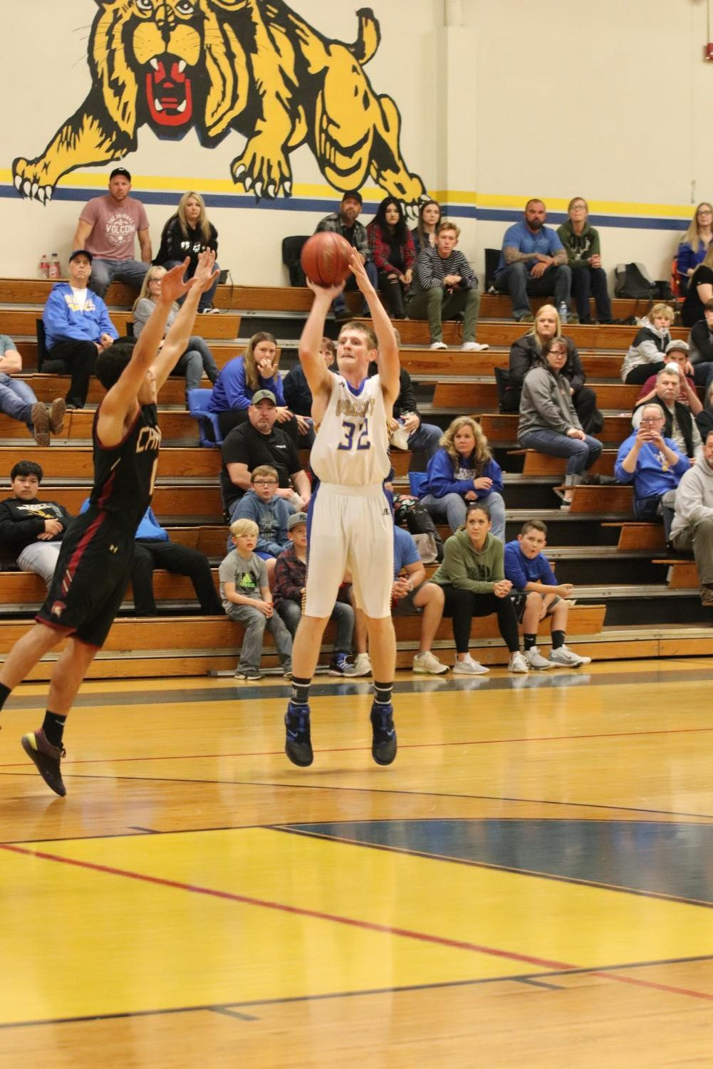 In an intense game against the Titans, Dylan Self hits a three pointer to help lead his team to an important win.