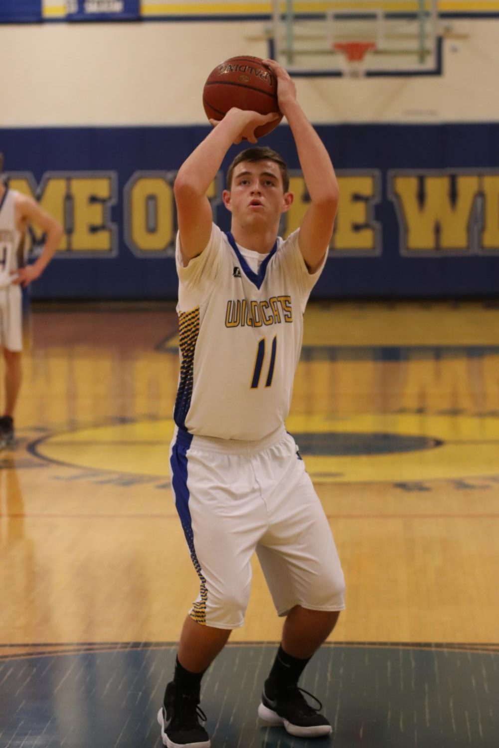During the blowout victory for the TUHS boys basketball team, Blake Smith shoots free-throws to contribute to their win.