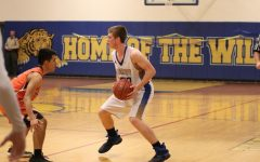 TUHS boys basketball advances in playoffs