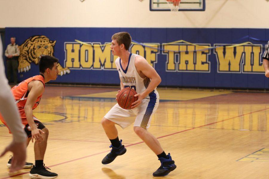 TUHS boys basketball advances in playoffs