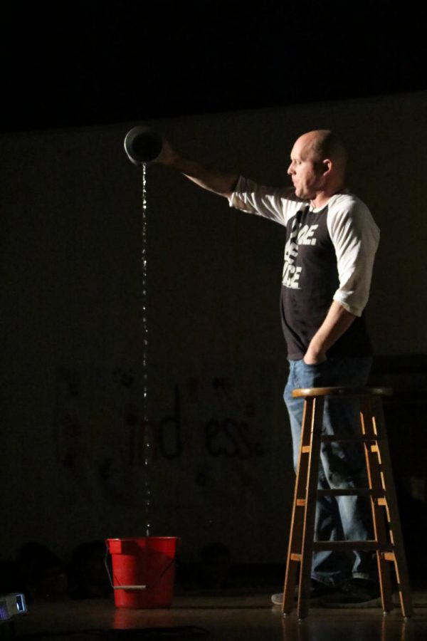 Eric Newton pouring the endless stream into the bucket below.