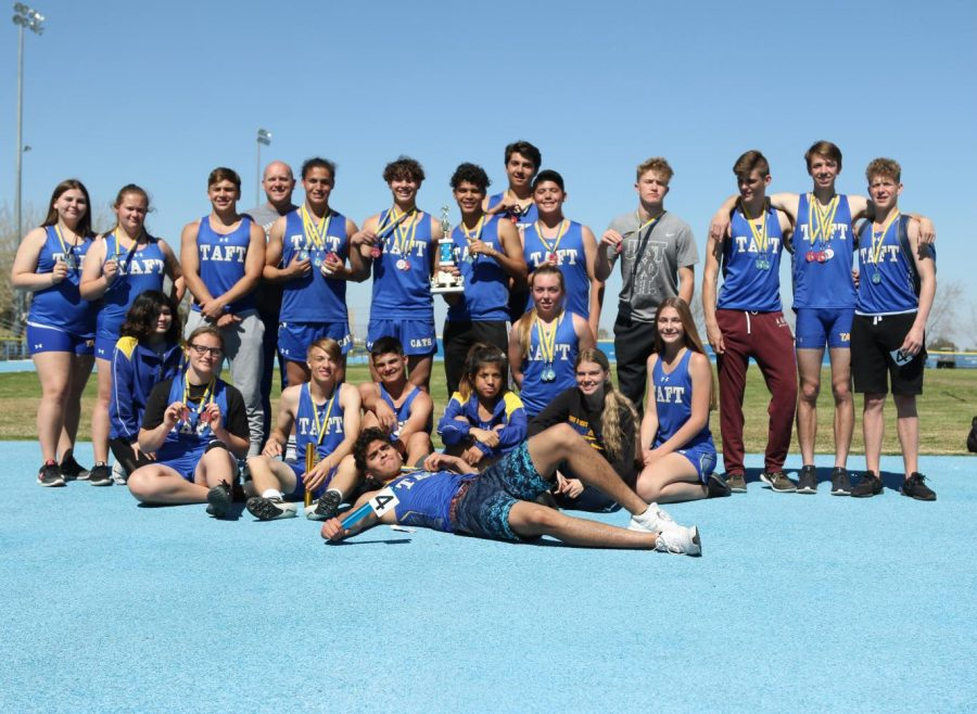 The Taft Union High School Track and Field team taking their victory picture and showing off their medals after the Wildcat Invitational.  The men's team placed first overall. The women's team placed second.