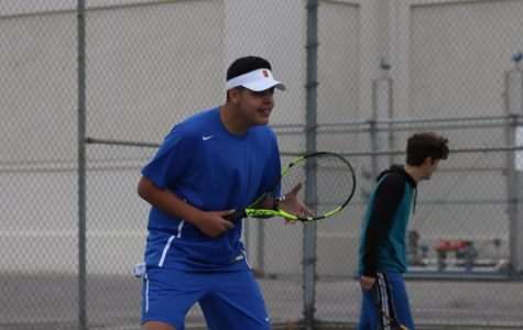 Senior Juan Guerrero in his playing stance as his opponent serves the ball. Juan was able to win his game in two sets and later won in doubles as well.