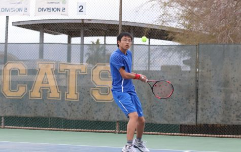 Singles #2 Tyler Nyguen swinging his racket at the ball. Tyler won his match in the third set 10-7.