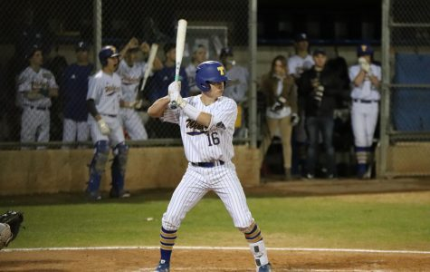 During the varsity baseball team's home victory against Ridgeview, Chad Berry steps up to bat to help contribute to their victory.