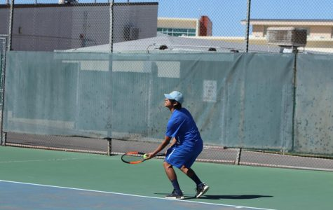Senior Marvin Gama serving the ball in his singles game. Marvin is doing great this season is only getting better game by game.